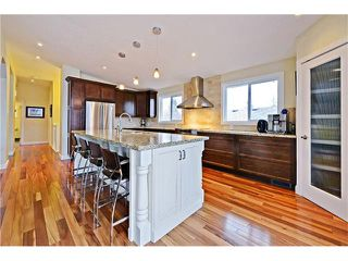 Photo 7: 8 LORNE Place SW in Calgary: North Glenmore Park House for sale : MLS®# C4052972