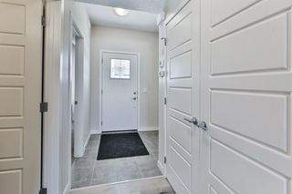 Photo 3: 104 115 SAGEWOOD Drive SW: Airdrie Row/Townhouse for sale : MLS®# C4294487