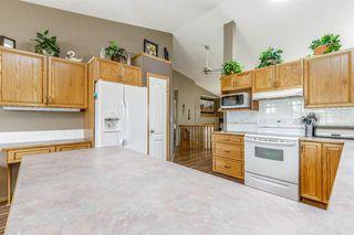 Photo 4: 64 WEST EDGE Road: Cochrane Detached for sale : MLS®# A1025928