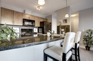 Photo 5: 6 305 VILLAGE Mews SW in CALGARY: Prominence_Patterson Condo for sale (Calgary)  : MLS®# C3599226