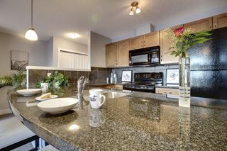 Photo 6: 6 305 VILLAGE Mews SW in CALGARY: Prominence_Patterson Condo for sale (Calgary)  : MLS®# C3599226