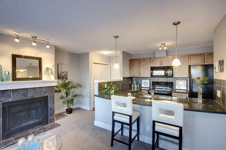 Photo 4: 6 305 VILLAGE Mews SW in CALGARY: Prominence_Patterson Condo for sale (Calgary)  : MLS®# C3599226