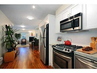 """Main Photo: 103 1672 E PENDER Street in Vancouver: Hastings Townhouse for sale in """"PENDER PLACE"""" (Vancouver East)  : MLS®# V1046826"""