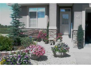 Photo 2: 85 RIVER HEIGHTS View: Cochrane Residential Attached for sale : MLS®# C3603974