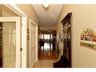 Photo 3: 85 RIVER HEIGHTS View: Cochrane Residential Attached for sale : MLS®# C3603974