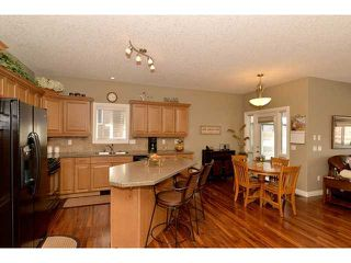 Photo 6: 85 RIVER HEIGHTS View: Cochrane Residential Attached for sale : MLS®# C3603974