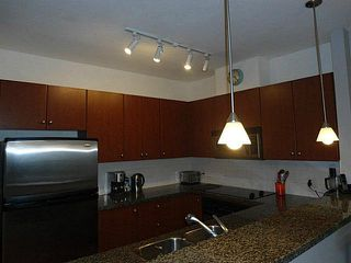 Photo 6: 104 100 CAPILANO Road in Port Moody: Port Moody Centre Condo for sale : MLS®# V1101530