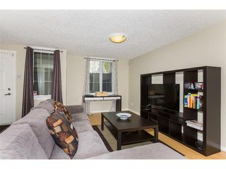 Photo 7: 115 McKenzie Towne Close E in Calgary: McKenzie Towne House for sale : MLS®# C4010193
