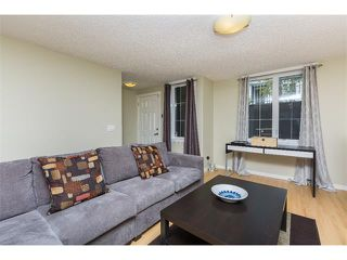 Photo 6: 115 McKenzie Towne Close E in Calgary: McKenzie Towne House for sale : MLS®# C4010193
