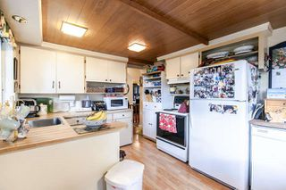 Photo 5: 7056 HILLVIEW Street in Burnaby: Government Road House for sale (Burnaby North)  : MLS®# R2039855