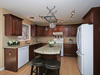 Photo 8: 114 SIGNATURE Close SW in Calgary: Signal Hill House for sale