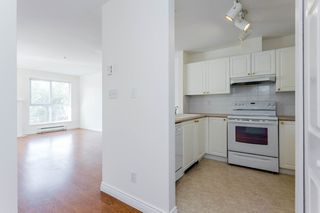 "Photo 2: 405 13727 74 Avenue in Surrey: East Newton Condo for sale in ""Kings Court"" : MLS®# R2201896"