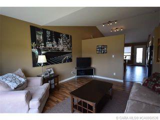 Photo 1: 147 JORDAN Parkway in Red Deer: RR Johnstone Crossing Residential for sale : MLS®# CA0060538