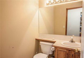 Photo 12: 94 CRYSTALRIDGE Crescent: Okotoks House for sale : MLS®# C4184670