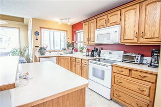 Photo 6: 94 CRYSTALRIDGE Crescent: Okotoks House for sale : MLS®# C4184670