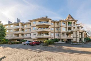 "Photo 1: 213 20120 56 Avenue in Langley: Langley City Condo for sale in ""Black Berry Lane 1"" : MLS®# R2326828"