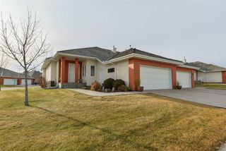 Photo 1: #49 1225 WANYANDI Road in Edmonton: Zone 22 House Half Duplex for sale : MLS®# E4170623