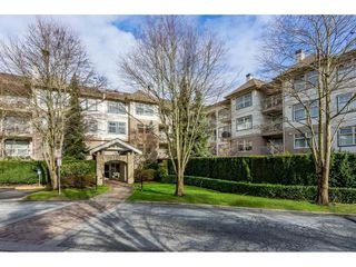 "Photo 1: 415 15210 GUILDFORD Drive in Surrey: Guildford Condo for sale in ""Boulevard Club"" (North Surrey)  : MLS®# R2433481"