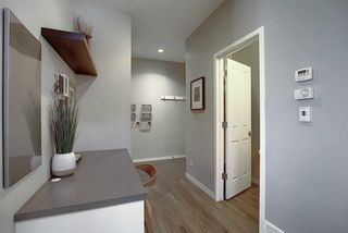 Photo 8: 1023 BRIGHTONCREST Green SE in Calgary: New Brighton Detached for sale : MLS®# A1014253