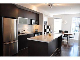 Photo 4: 44 101 FRASER Street in Port Moody: Port Moody Centre Condo for sale : MLS®# V995777
