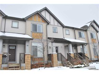 Photo 1: 41 300 EVANSCREEK CRT NW in Calgary: Evanston Townhouse  : MLS®# C3545193