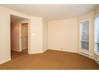 """Photo 12: 103 9978 148TH Street in Surrey: Guildford Condo for sale in """"HIGHPOINT GARDENS"""" (North Surrey)  : MLS®# F1430440"""