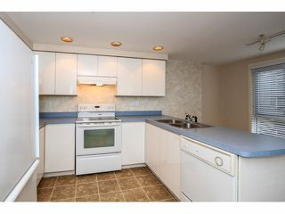 """Photo 9: 103 9978 148TH Street in Surrey: Guildford Condo for sale in """"HIGHPOINT GARDENS"""" (North Surrey)  : MLS®# F1430440"""