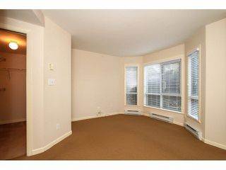 """Photo 11: 103 9978 148TH Street in Surrey: Guildford Condo for sale in """"HIGHPOINT GARDENS"""" (North Surrey)  : MLS®# F1430440"""
