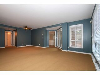 """Photo 6: 103 9978 148TH Street in Surrey: Guildford Condo for sale in """"HIGHPOINT GARDENS"""" (North Surrey)  : MLS®# F1430440"""