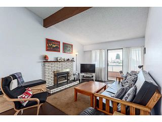 "Photo 1: 205 6904 FRASER Street in Vancouver: South Vancouver Condo for sale in ""CASA BLANCA"" (Vancouver East)  : MLS®# V1138535"