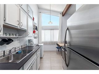 """Photo 12: 205 6904 FRASER Street in Vancouver: South Vancouver Condo for sale in """"CASA BLANCA"""" (Vancouver East)  : MLS®# V1138535"""