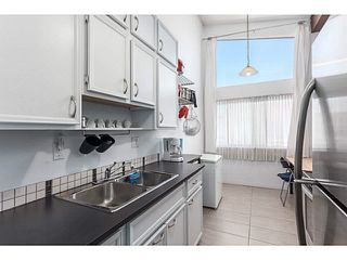 "Photo 4: 205 6904 FRASER Street in Vancouver: South Vancouver Condo for sale in ""CASA BLANCA"" (Vancouver East)  : MLS®# V1138535"