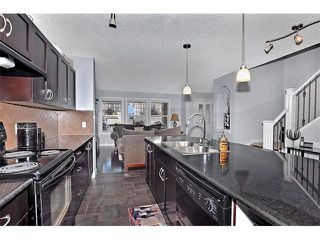 Photo 11: 2092 LUXSTONE Boulevard SW: Airdrie House for sale : MLS®# C4032728