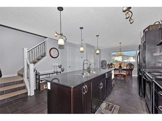 Photo 9: 2092 LUXSTONE Boulevard SW: Airdrie House for sale : MLS®# C4032728