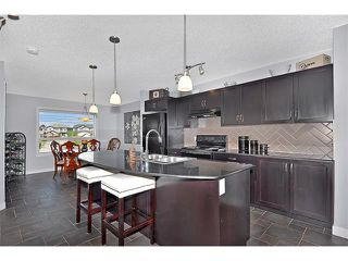 Photo 7: 2092 LUXSTONE Boulevard SW: Airdrie House for sale : MLS®# C4032728