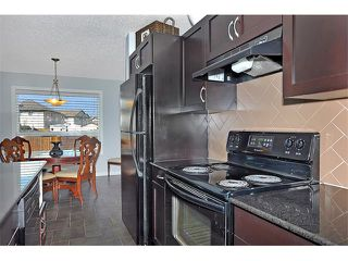 Photo 10: 2092 LUXSTONE Boulevard SW: Airdrie House for sale : MLS®# C4032728