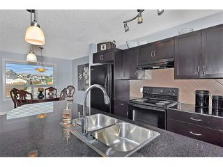 Photo 8: 2092 LUXSTONE Boulevard SW: Airdrie House for sale : MLS®# C4032728