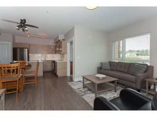 """Photo 7: 301 5811 177B Street in Surrey: Cloverdale BC Condo for sale in """"Latis"""" (Cloverdale)  : MLS®# R2084477"""