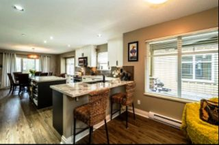 """Photo 3: 57 41050 TANTALUS Road in Squamish: Tantalus Townhouse for sale in """"Greenside Estates"""" : MLS®# R2154048"""