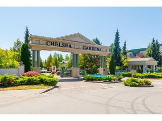 "Photo 1: 223 13880 70 Avenue in Surrey: East Newton Condo for sale in ""CHELSEA GARDENS"" : MLS®# R2167661"