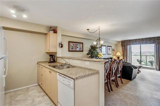 Photo 8: 1423 8 BRIDLECREST Drive SW in Calgary: Bridlewood Condo for sale : MLS®# C4138425