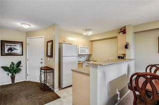 Photo 4: 1423 8 BRIDLECREST Drive SW in Calgary: Bridlewood Condo for sale : MLS®# C4138425
