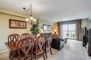 Photo 9: 1423 8 BRIDLECREST Drive SW in Calgary: Bridlewood Condo for sale : MLS®# C4138425