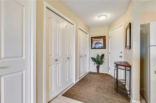 Photo 3: 1423 8 BRIDLECREST Drive SW in Calgary: Bridlewood Condo for sale : MLS®# C4138425