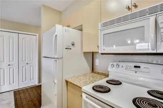Photo 6: 1423 8 BRIDLECREST Drive SW in Calgary: Bridlewood Condo for sale : MLS®# C4138425