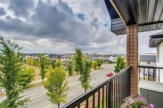 Photo 2: 1423 8 BRIDLECREST Drive SW in Calgary: Bridlewood Condo for sale : MLS®# C4138425