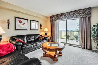 Photo 12: 1423 8 BRIDLECREST Drive SW in Calgary: Bridlewood Condo for sale : MLS®# C4138425
