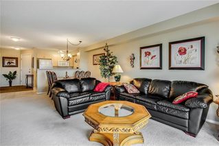 Photo 13: 1423 8 BRIDLECREST Drive SW in Calgary: Bridlewood Condo for sale : MLS®# C4138425