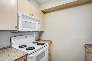 Photo 5: 1423 8 BRIDLECREST Drive SW in Calgary: Bridlewood Condo for sale : MLS®# C4138425