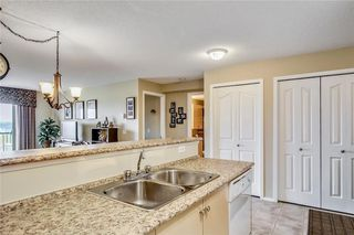 Photo 7: 1423 8 BRIDLECREST Drive SW in Calgary: Bridlewood Condo for sale : MLS®# C4138425